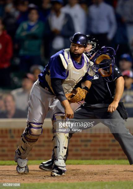 Catcher Wilin Rosario of the Colorado Rockies throws to third base during the eighth inning against the Chicago Cubs on July 28 2014 at Wrigley Field...