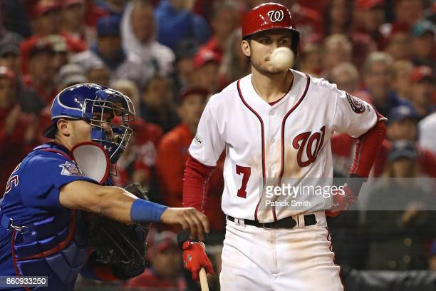 Catcher Willson Contreras of the Chicago Cubs throws the ball in front of batter Trea Turner of the Washington Nationals to pickoff Jose Lobaton of...