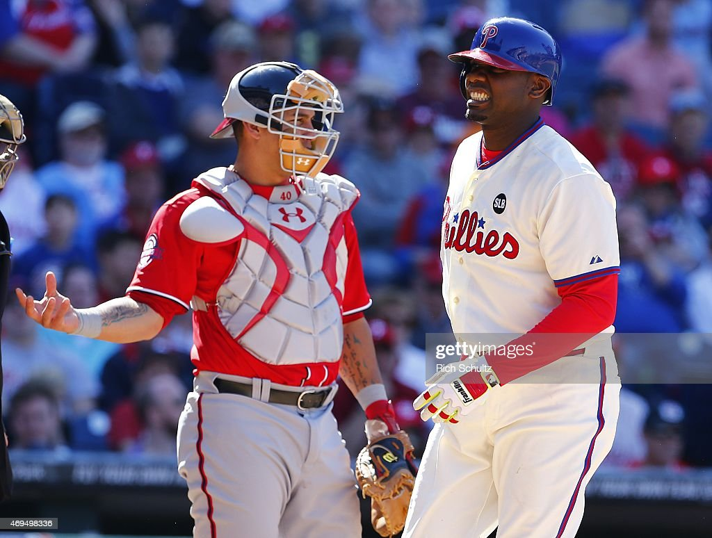 Catcher Wilson Ramos #40 of the Washington Nationals gets a ball as Ryan Howard #6 of the Philadelphia Phillies reacts after striking out for the fourth time in the game at Citizens Bank Park on April 12, 2015 in Philadelphia, Pennsylvania. The Nationals defeated the Phillies 4-3.