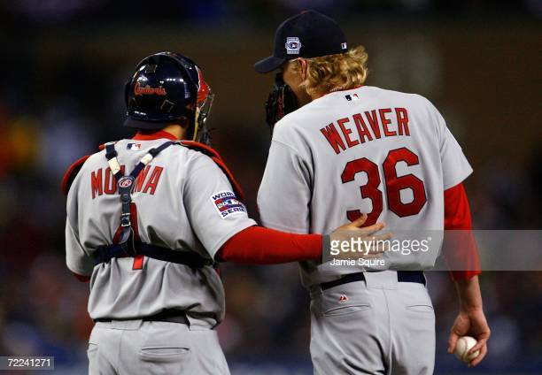 Catcher Yadier Molina and Jeff Weaver of the St. Louis Cardinals talk on the mound the Detroit Tigers during Game Two of 2006 World Series October...