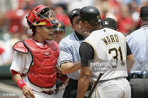 Catcher Yadier Molina of the St Louis Cardinals argues with Daryle Ward of the Pittsburgh Pirates in the first inning at Busch Stadium in St Louis Mo...