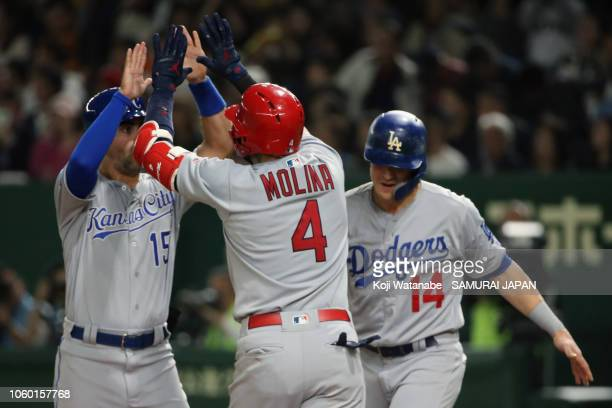 Catcher Yadier Molina of the St Louis Cardinals celebrates after hitting a threerun home run to make it 51 with Infielder Whit Merrifield of the...