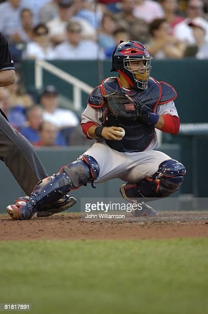 Catcher Yadier Molina of the St. Louis Cardinals fields his position as he looks to the runner on base after receiving the pitch from the pitcher...