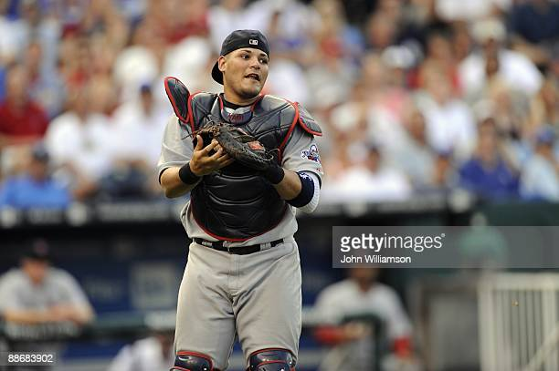 Catcher Yadier Molina of the St Louis Cardinals fields his position as he catches a pop fly out in front of home plate during the game against the...