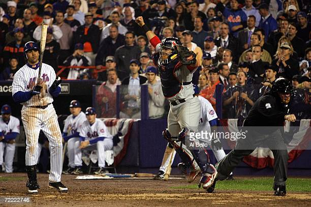 Catcher Yadier Molina of the St. Louis Cardinals reacts after Carlos Beltran of the New York Mets stikes out to end game seven of the NLCS at Shea...