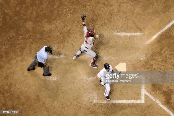 Catcher Yadier Molina of the St Louis Cardinals reacts after Mark Kotsay of the Milwaukee Brewers for the final out of the Game Six of the National...