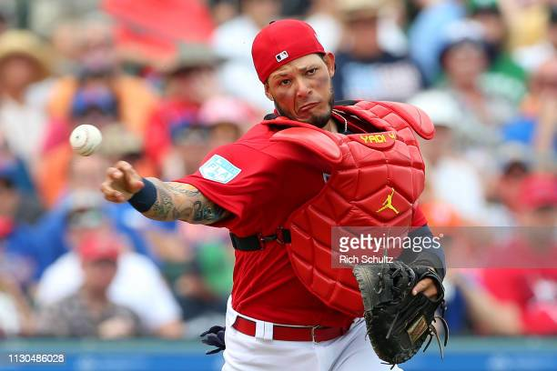 Catcher Yadier Molina of the St Louis Cardinals throws to get Jeff McNeil of the New York Mets out at first base base during the third inning of a...