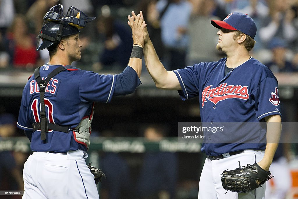 Catcher Yan Gomes #10 celebrates with closer Matt Albers #32 of the Cleveland Indians after defeating the Philadelphia Phillies at Progressive Field on April 30, 2013 in Cleveland, Ohio. The Indians defeated the Phillies 14-2.