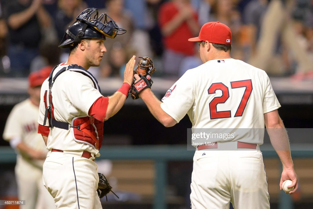 Catcher Yan Gomes #10 celebrates with closing pitcher Bryan Shaw #27 of the Cleveland Indians after the Indians defeated the Baltimore Orioles at Progressive Field on August 16, 2014 in Cleveland, Ohio. The Indians defeated the Orioles 6-0.