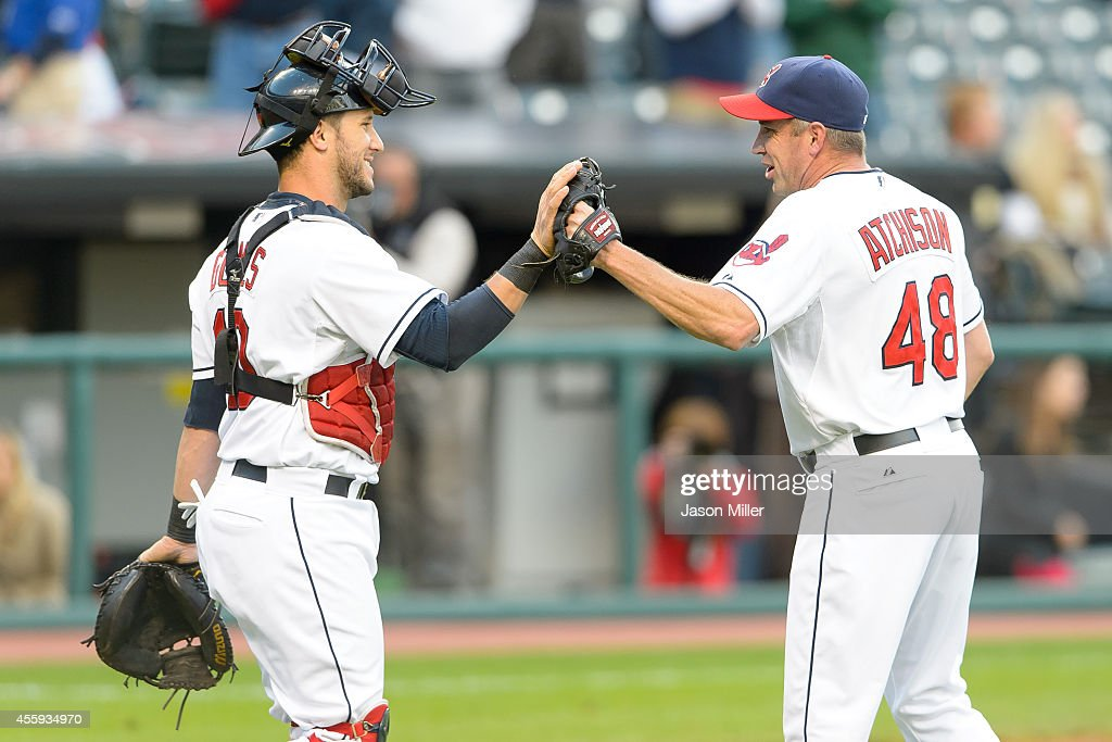 Catcher Yan Gomes #10 celebrates with closing pitcher Scott Atchison #48 of the Cleveland Indians after the Indians defeated the Kansas City Royals 4-3 after the resumed 10th inning of the August 31 suspended game in Kansas City at Progressive Field on September 22, 2014 in Cleveland, Ohio.