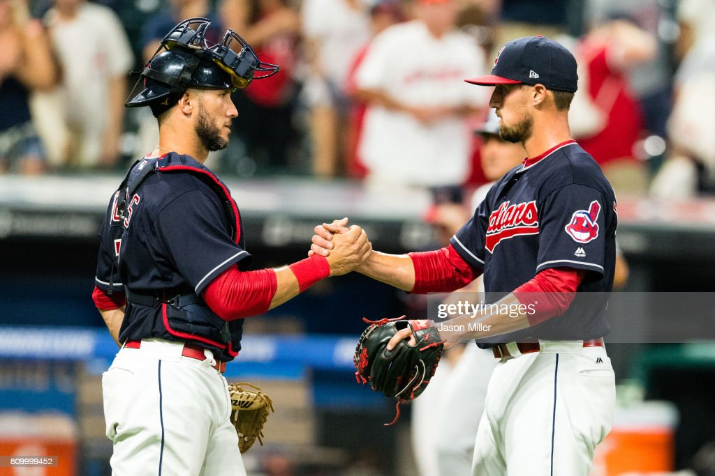 Catcher Yan Gomes #7 celebrates with closing pitcher Shawn Armstrong #51 of the Cleveland Indians after the Indians defeated the San Diego Padres at Progressive Field on JULY 6, 2017 in Cleveland, Ohio. The Indians defeated the Padres 9-2.