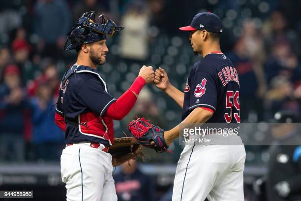 Catcher Yan Gomes celebrates with starting pitcher Carlos Carrasco of the Cleveland Indians after the Indians defeated the Detroit Tigers at...