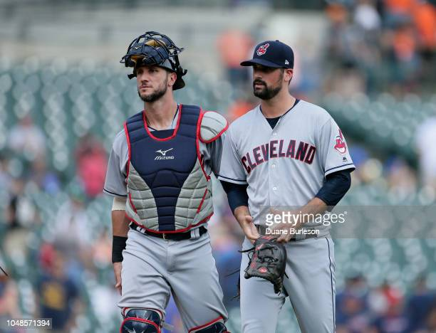 Catcher Yan Gomes of the Cleveland Indians and relief pitcher Adam Plutko of the Cleveland Indians following a win over the Detroit Tigers at...