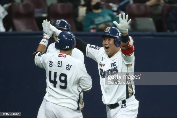 Catcher Yang Eui-Ji of NC Dinos reacts after hitting two home runs in the bottom of sixth inning during the Korean Series Game Five between Doosan...
