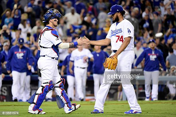 Catcher Yasmani Grandal and Kenley Jansen of the Los Angeles Dodgers celebrate the Dodgers 6-0 win against the Chicago Cubs in game three of the...