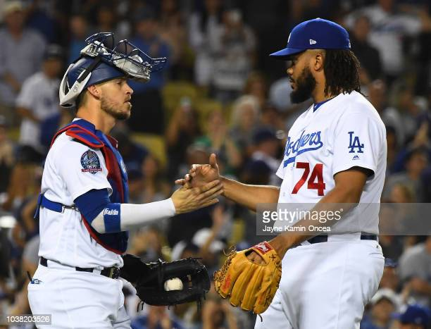 Catcher Yasmani Grandal and pitcher Kenley Jansen of the Los Angeles Dodgers shake hands after Jansen earns his 37th save of the season to defeat the...