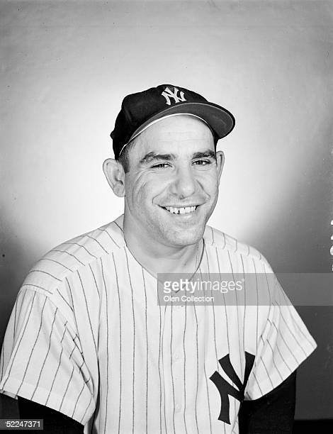 Catcher Yogi Berra of the New York Yankees poses for the camera at Yankee Stadium in New York in 1956