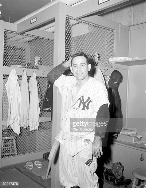 Catcher Yogi Berra of the New York Yankees poses for the camera in the lockerroom after a game at Yankee Stadium in New York in 1958