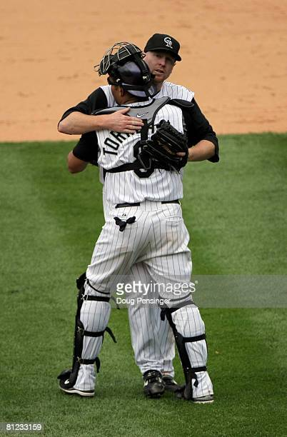 Catcher Yorvit Torrealba of the Colorado Rockies celebrates with starting pitcher Aaron Cook after he pitched a complete game and earned the win...