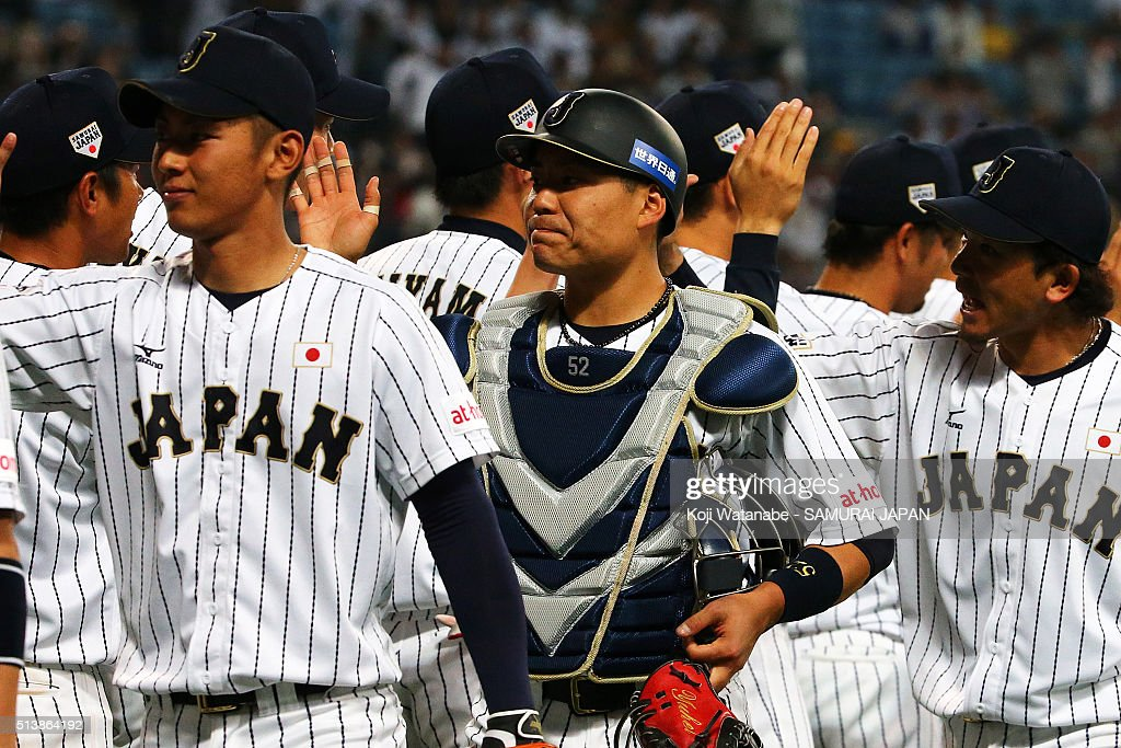 Catcher Yuhei Nakamura of Japan #52 of Japan celerates after winning during the international friendly match between Japan and Chinese Taipei at the Nagoya Dome on March 5, 2016 in Nagoya, Aichi, Japan.