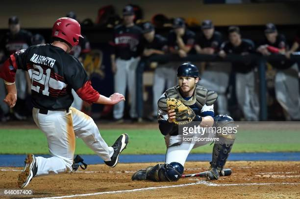 FIU catcher Zack Soria prepares to tag Jacksonville State first baseman Andrew Naismith in the third inning as the FIU Golden Panthers faced the...