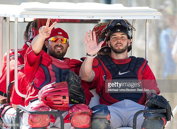 Catchers Ali Solis left and Blake Swihart of the Boston Red Sox ride off the practice field on February 25 2016 at Fenway South in Fort Myers Florida