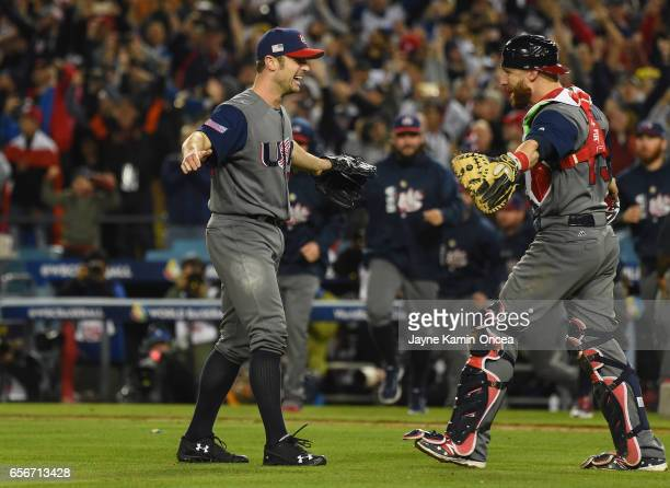 Catchers Buster Posey and Jonathan Lucroy of team United States celebrate their 80 win over team Puerto Rico during Game 3 of the Championship Round...