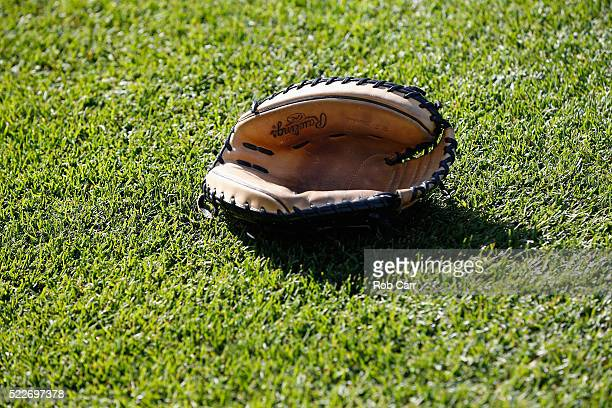 A catchers mitt sits on the grass before the start of the Toronto Blue Jays and Baltimore Orioles game at Oriole Park at Camden Yards on April 20...