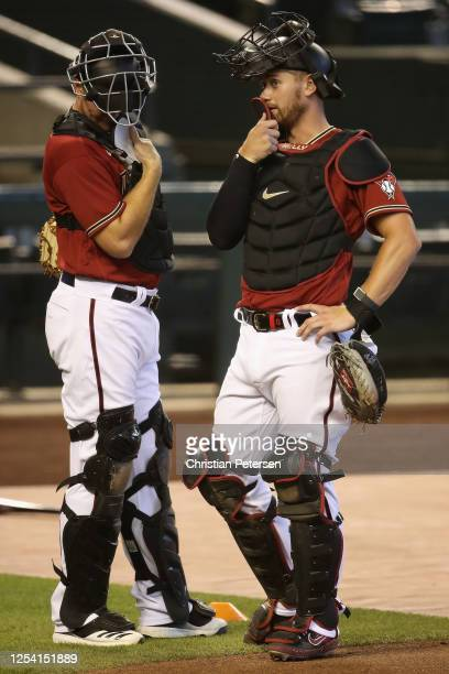 Catchers Stephen Vogt and Carson Kelly talk as they participates in summer workouts ahead of the abbreviated MLB season at Chase Field on July 03...