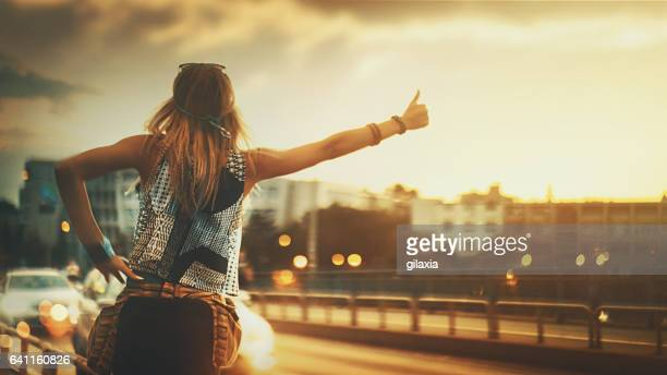 catching a ride. - hitchhiking stock pictures, royalty-free photos & images
