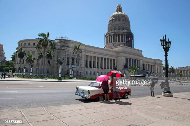 Catching a taxi ride in Havana