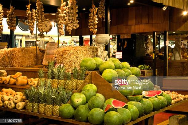 catching fruit market stand - adelaide market stock pictures, royalty-free photos & images