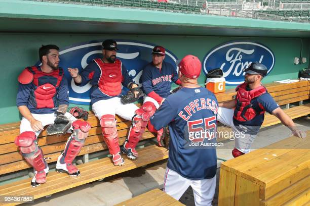 Catching instructor Chad Epperson the Boston Red Sox talks to Blake Swihart Sandy Leon Christian Vazquez and Dan Butler prior to a spring training...