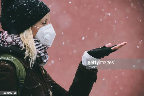 catching snowflakes on the walk - fingerless gloves stock pictures, royalty-free photos & images