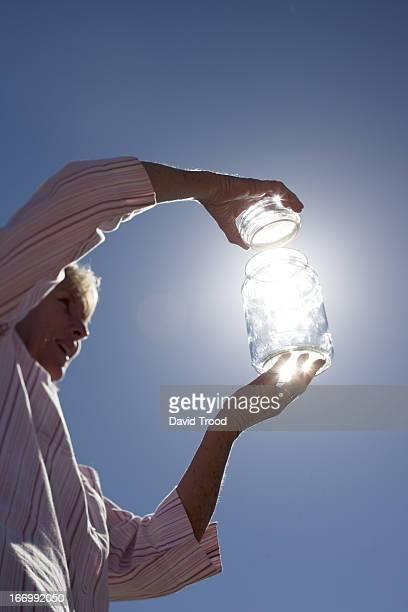 Catching sunlight in a bottle.