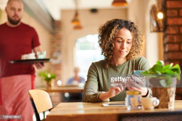 catching up at the coffee shop - internet cafe stock pictures, royalty-free photos & images