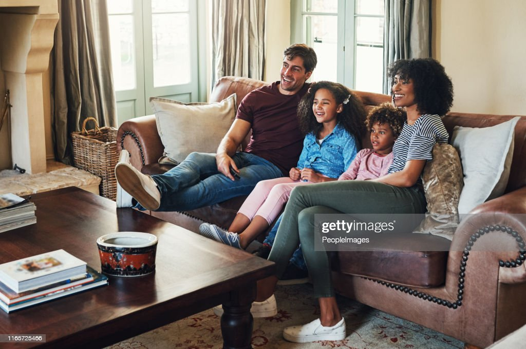 Catching up on our favorite shows together : Stock Photo