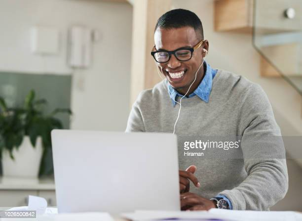 catching up on some coursework through distance learning - e learning stock photos and pictures