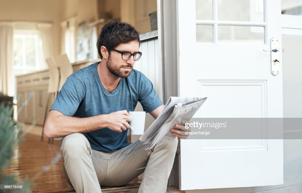 Catching up on the latest news : Stock Photo