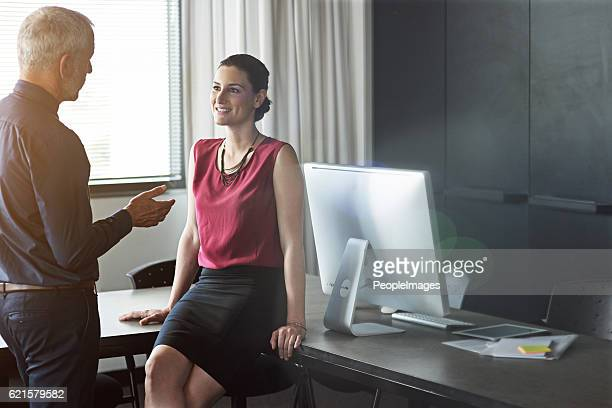 catching up with a colleague - peopleimages stock pictures, royalty-free photos & images