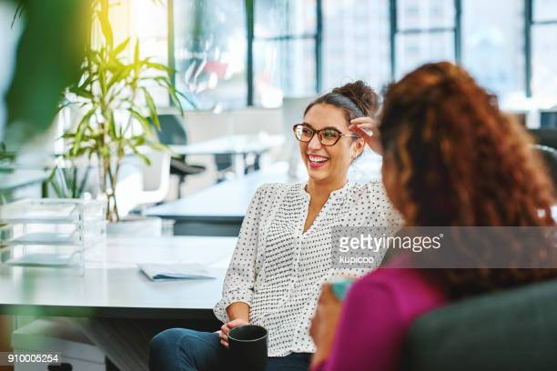 catching up with a colleague - happy stock photos and pictures