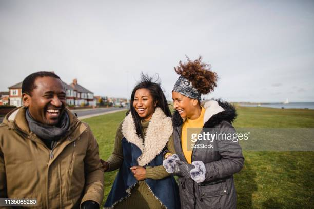 catching up with family - black stock pictures, royalty-free photos & images