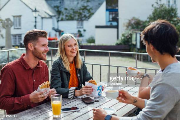 catching up with friends in cornwall - cornish pasty stock pictures, royalty-free photos & images