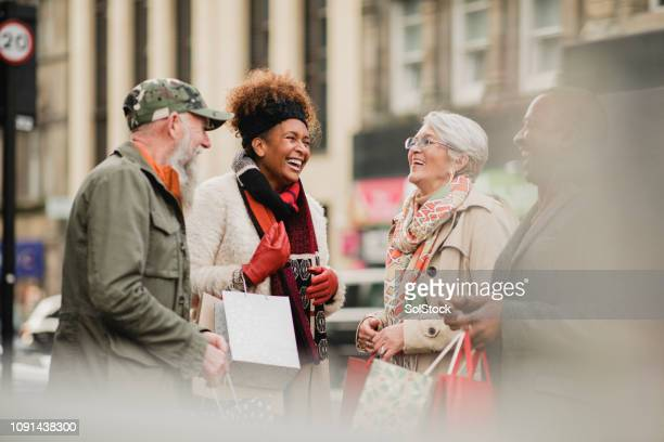 catching up with friends - hello december stock pictures, royalty-free photos & images