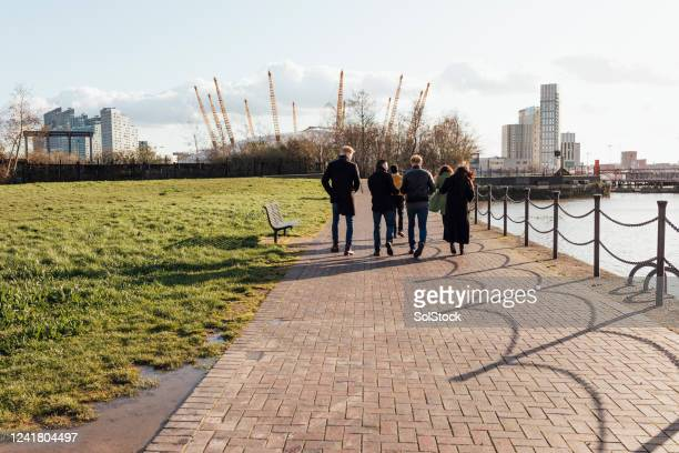 catching up with friends - waterfront stock pictures, royalty-free photos & images