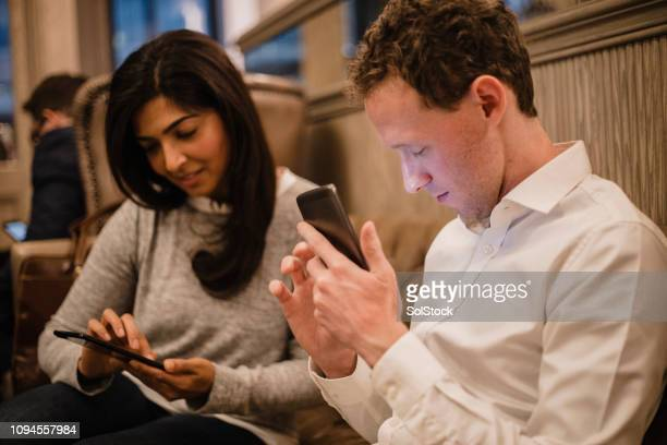 catching up with social media - assistive technology stock photos and pictures
