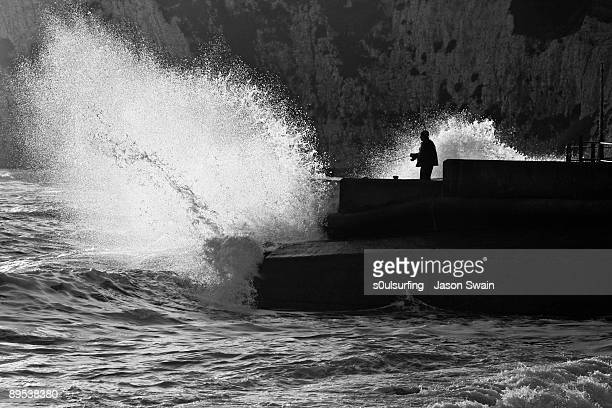 catching waves - extreme fishing - s0ulsurfing stock pictures, royalty-free photos & images