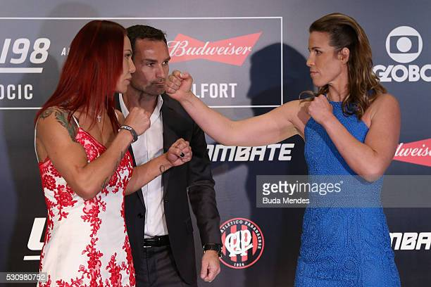 Catchweight fighters Cris Cyborg Justino of Brazil and Leslie Smith of the United States face off during Ultimate Media Day at Arena da Baixada...