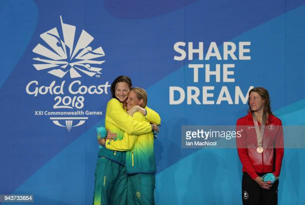 Cate and Bronte Campbell of Australia hug on the podium after winning gold and silver in the Women's 100m Freestyle final on day five of the Gold...