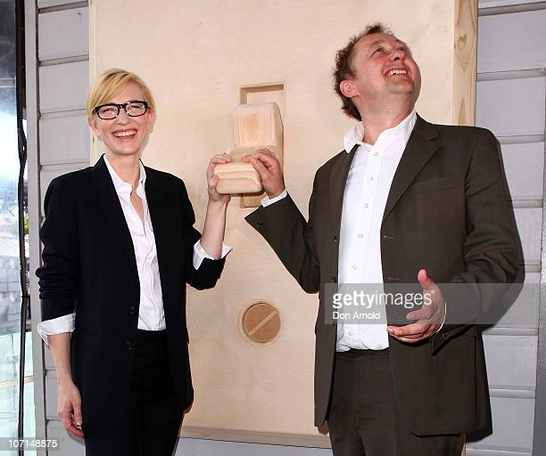 Cate Blanchett and Andrew Upton flick a faux switch at an event to celebrate the 'switchon' of the Sydney Theatre Company's rooftop solar panels at...